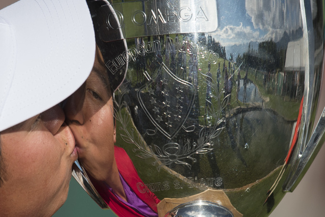 Winner David Lipsky of the USA kiss the trophy after the final round of the Omega European Masters Golf Tournament in Crans-Montana, Switzerland, Sunday, Sept. 7, 2014. (AP Photo/Keystone,Ennio Le ...
