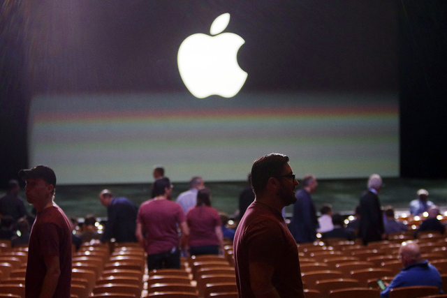 Guests and employees prepare for the start of an Apple event on Tuesday, Sept. 9, 2014, in Cupertino, Calif. Along with larger iPhones, Apple is poised to unveil a wearable device — marking ...