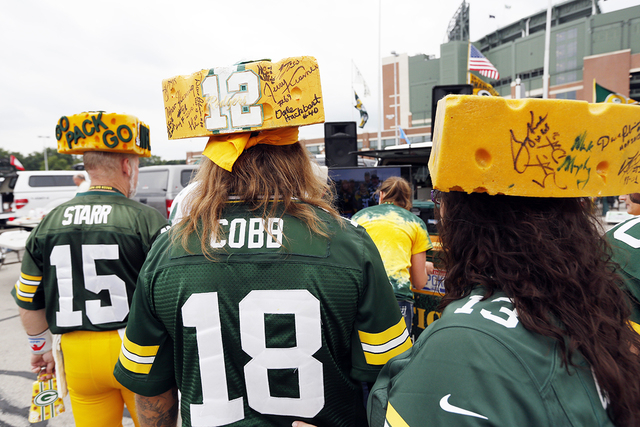 Fans tailgate before an NFL football preseason game between the Green Bay Packers and the Kansas City Chiefs Thursday, Aug. 28, 2014, in Green Bay, Wis. (AP Photo/Mike Roemer)