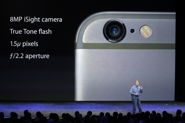 Phil Schiller, Apple's senior vice president of worldwide product marketing, discusses the camera features on the new iPhone 6 and iPhone 6 plus on Tuesday, Sept. 9, 2014, in Cupertino, Calif. (AP ...