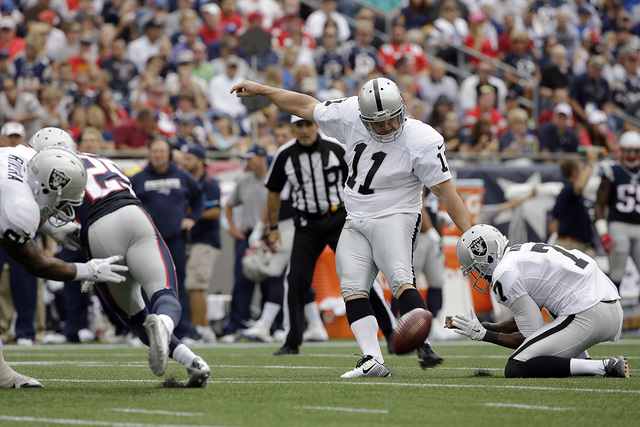 Oakland Raiders kicker Sebastian Janikowski (11) connects for a field goal in the second half of an NFL football game against the New England Patriots Sunday, Sept. 21, 2014, in Foxborough, Mass.  ...