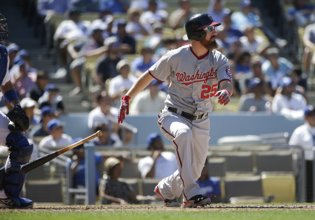 Washington Nationals' Adam LaRoche hits a two-run home run to tie the game during the ninth inning of a baseball game against the Los Angeles Dodgers Wednesday, Sept. 3, 2014, in Los Angeles. (AP  ...