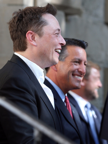 Tesla Motors CEO Elon Musk, left, and Nevada Gov. Brian Sandoval announce Nevada as the new site for a $5 billion car battery gigafactory, during a press conference at the Capitol in Carson City,  ...