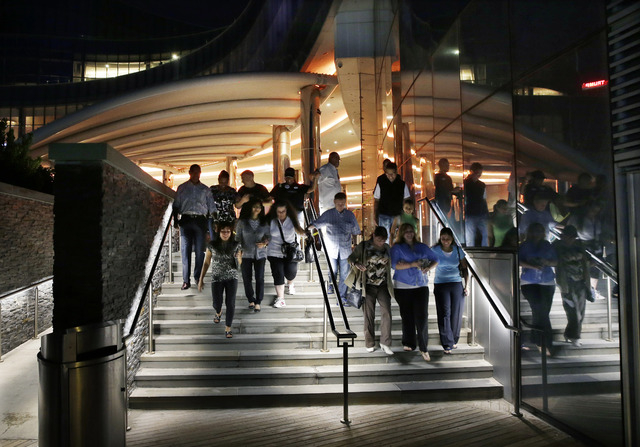 Casino workers and customers walk out of The Revel Hotel Casino together early in the morning Tuesday, Sept. 2, 2014, in Atlantic City, N.J.  The casino section of the Revel closed at 6:30 a.m.Tue ...