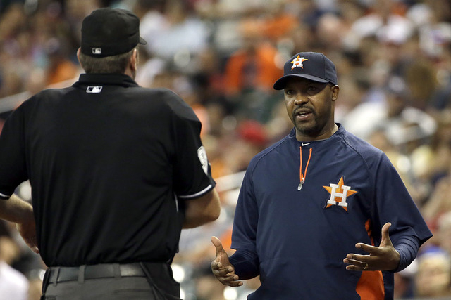 Houston Astros manager Bo Porter, right, talks to home plate umpire Chris Conroy, left, about the condition of the pitchers mound during the third inning of a baseball game against the Toronto Blu ...