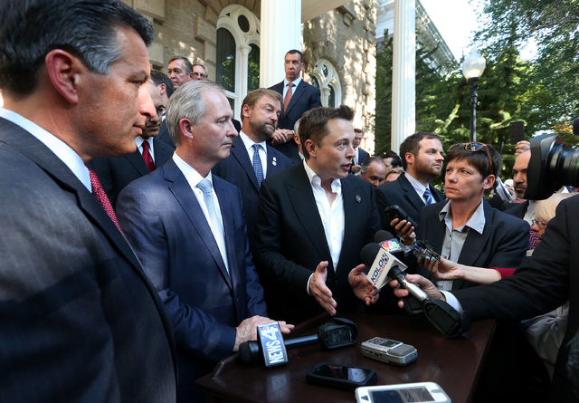 From left, Nevada Gov. Brian Sandoval, Steve Hill, executive director of the Governor's office of economic development, and Telsa Motors CEO Elon Musk answer media questions following a press conf ...