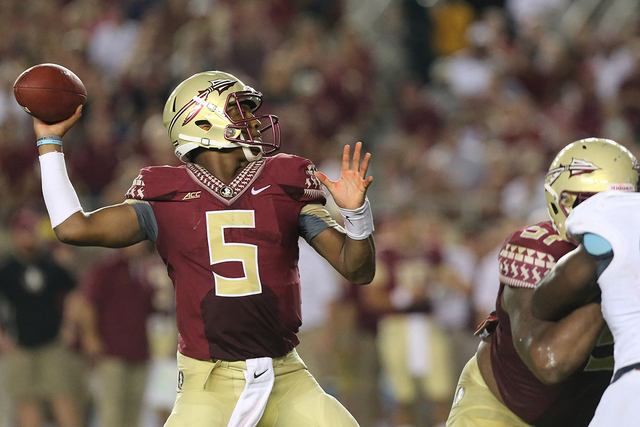 Florida State's Jameis Winston passes against The Citadel in the third quarter of an NCAA college football game on Saturday, Sept. 6, 2014 in Tallahassee, Fla. (AP Photo/Steve Cannon)