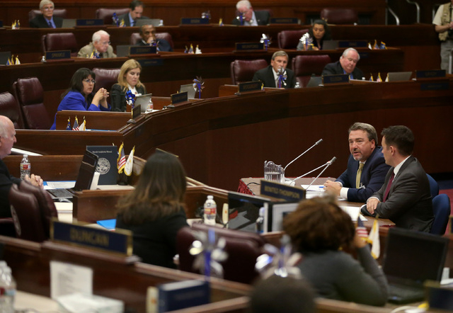 Tony Sanchez of NV Energy, left, and Paul Thomsen, with the Nevada Office of Energy, answer questions from lawmakers during a special session of the Nevada Legislature in Carson City on Wednesday, ...