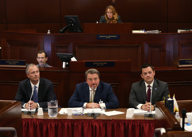From left, Steve Hill with the Nevada Office of Economic Development, Tony Sanchez with NV Energy and Paul Thomsen with the Nevada Office of Energy, answer questions from lawmakers during a specia ...
