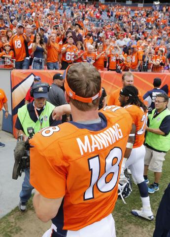 Denver Broncos quarterback Peyton Manning (18) walks off the field after an NFL football game against the Kansas City Chiefs, Sunday, Sept. 14, 2014, in Denver. The Broncos won 24-17. (AP Photo/Ja ...