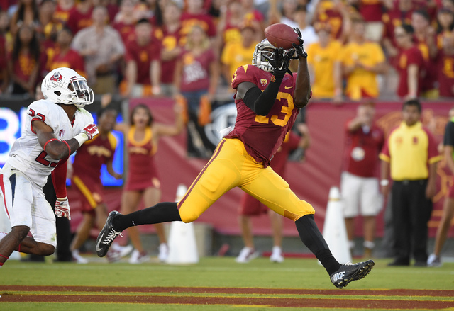 Southern California tight end Bryce Dixon catches a touchdown pass over the Fresno State defense as the Trojans routed the Bulldogs, 52-13, on Saturday. (AP Photo/Mark J. Terrill)