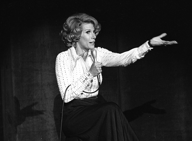 In this Aug. 13, 1975 photo released by the Las Vegas News Bureau, comedian Joan Rivers performs at the MGM in Las Vegas, Nev. Rivers, the raucous, acid-tongued comedian who crashed the male-domin ...