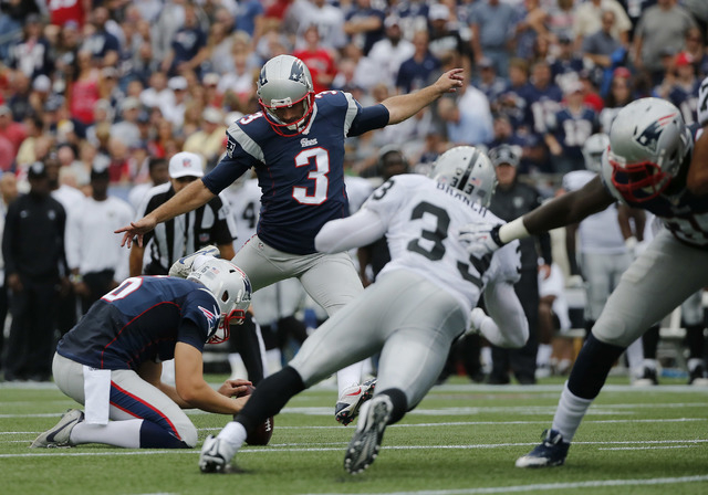 New England Patriots kicker Stephen Gostkowski (3) kicks a field goal against the Oakland Raiders in the first half of an NFL football game Sunday, Sept. 21, 2014, in Foxborough, Mass. Holding the ...