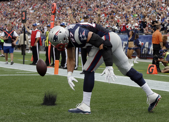 New England Patriots tight end Rob Gronkowski celebrates his touchdown catch against the Oakland Raiders in the first half of an NFL football game Sunday, Sept. 21, 2014, in Foxborough, Mass. (AP  ...