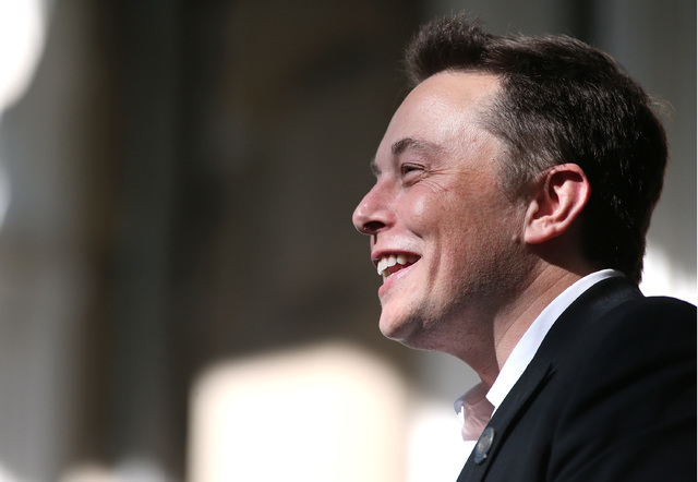 Tesla Motors CEO Elon Musk speaks at a press conference after Nevada was chosen as the new site for a $5 billion car battery gigafactory, which will be built east of Reno. Several hundred people a ...