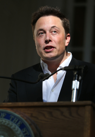 Tesla Motors CEO Elon Musk speaks at a news conference, Thursday, Sept. 4, 2014 in Carson City, Nev. Nevada Gov. Brian Sandoval announced Thursday that Tesla Motors will build a massive battery fa ...