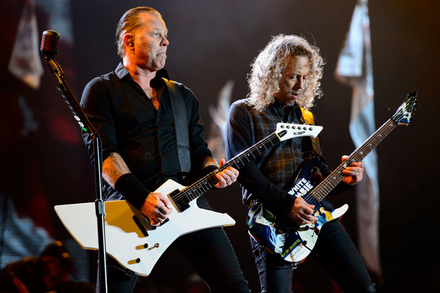 James Hetfield, left and Kirk Hammett, right from US band Metallica perform at Glastonbury music festival, England, Saturday, June 28, 2014. Thousands of music fans have arrived for the festival t ...