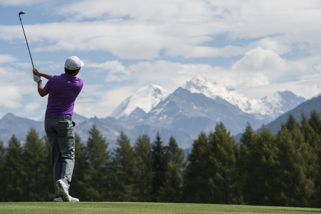 Winner David Lipsky of the USA tees of  at hole 12 during the final round of the Omega European Masters Golf Tournament in Crans-Montana, Switzerland, Sunday, Sept. 7, 2014. (AP Photo/Keystone, En ...
