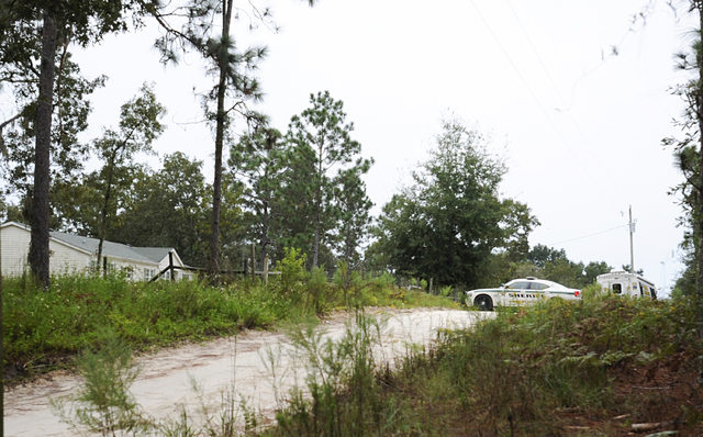 A Gilchrist County sheriff's vehicle sits on the property, Friday, Sept. 19, 2014, in Bell, Fla., where 51-year-old Don Spirit allegedly shot and killed his adult daughter and six of his grandchil ...