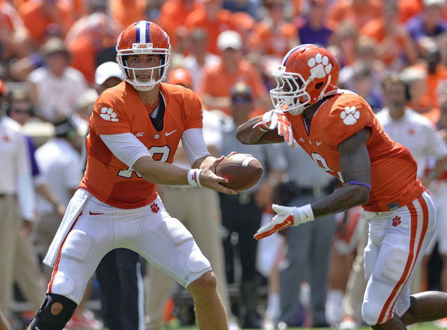 Clemson quarterback Cole Stoudt hands the ball off to running back Wayne Gallman Jr. during an NCAA college football game against South Carolina State in Clemson, S.C.,  Saturday, Sept. 6, 2014.   ...