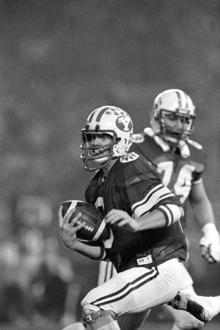 Brigham Young University quarterback Jim McMahon scrambles for yardage during his team's 38-36 victory over Washington State in the Holiday Bowl, Dec. 19, 1981, in San Diego.  McMahon, who threw f ...