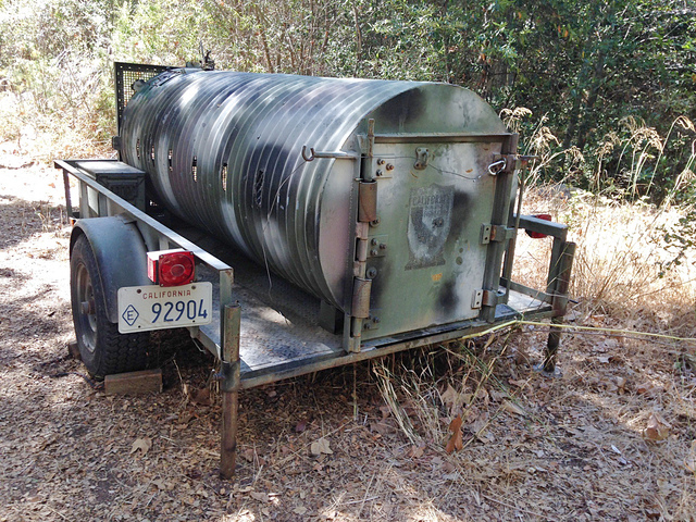 This photo provided by the California Department of Fish and Wildlife shows a bear trap, Thursday, Sept. 25, 2014, set in an attempt to capture a black bear that attacked a woman in Carpinteria, C ...