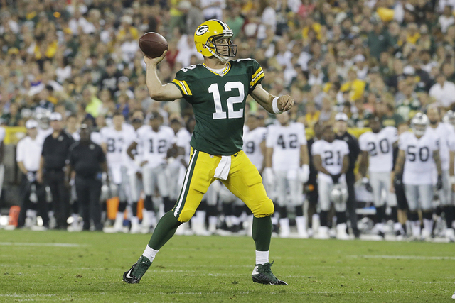 Green Bay Packers' Aaron Rodgers during the first half of an NFL preseason football game against the Oakland Raiders Friday, Aug. 22, 2014, in Green Bay, Wis. (AP Photo/Morry Gash)