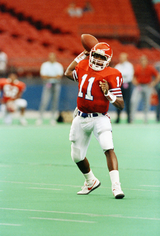 University of Houston quarterback Andre Ware, seen here Sept. 29, 1989, set or tied 27 NCAA records leading while the Cougars' high-powered offense. Houston opened the season with a 69-0 rout of U ...