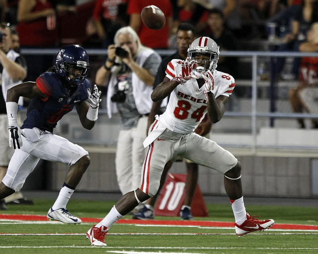 UNLV wide receiver Kendal Keys (84) makes a catch against Arizona during the second half of an NCAA college football game, Friday, Aug. 29, 2014, in Tucson, Ariz. (AP Photo/Rick Scuteri)