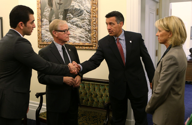 Nevada senators, from left, Ruben Kihuen, David Parks and Barbara Cegavske talk with Gov. Brian Sandoval, right center, at the Capitol in Carson City on Wednesday, Sept. 10, 2014. Sandoval called  ...