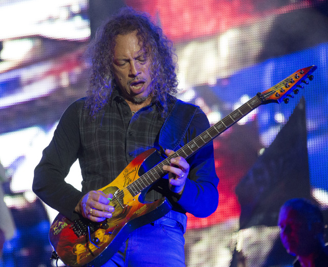 Kirk Hammett of Metallica performs on the main Pyramid stage at Glastonbury music festival, England, Saturday, June 28, 2014. More than 175,000 are expected to have arrived at Worthy Farm in Pilto ...