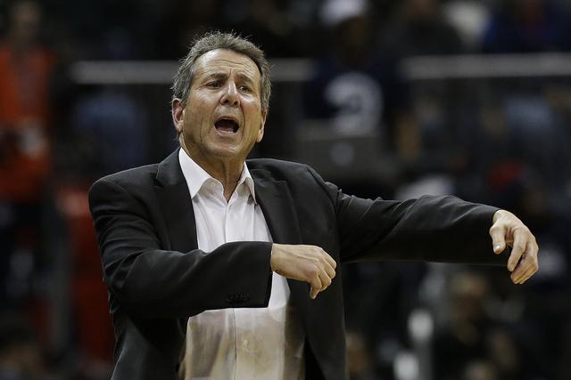 Atlanta Hawks managing partner Bruce Levenson yells at an official in the second half of an NBA  basketball game Wednesday, Dec. 4, 2013, in Atlanta.  Atlanta won 107-97. (AP Photo/John Bazemore)