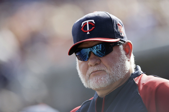 Minnesota Twins manager Ron Gardenhire is seen in the dugout during a baseball game against the Detroit Tigers in Detroit, Sunday, Sept. 28, 2014. (AP Photo/Carlos Osorio)