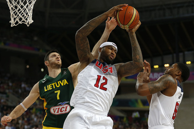 United States's DeMarcus Cousins,12, and  Lithuania's Darjus Lavrinovic, 7, jump for the rebound during their Basketball World Cup semifinal match at the Palau Sant Jordi in Barcelona, Spain, Thur ...