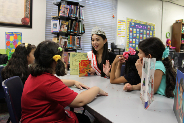 Miss Chinese Las Vegas Elisa Chan Reads to children at the Boys & Girls Clubs of Southern Nevada Sept. 8, 2014. Chan is one of several contestants preparing to participate in the Miss Asian Las Ve ...