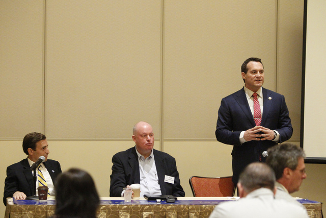 Nevada attorney general candidate Ross Miller, right, speaks during the opening remarks in his first debate against his opponent Adam Laxalt, left, at Aliante casino-hotel in North Las Vegas Satur ...
