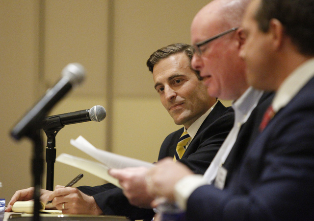 Nevada attorney general candidate Adam Laxalt, left, listens to moderator Steve Sebelius, center, Las Vegas Review-Journal columnist, during his first debate against his opponent Ross Miller at Al ...