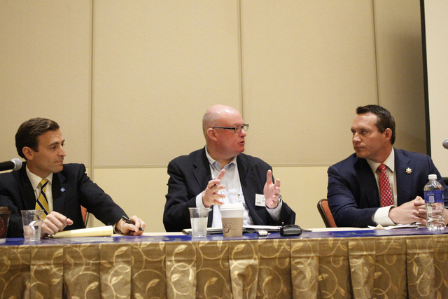 Nevada attorney general candidates Adam Laxalt, left, and his opponent Ross Miller, right, listen to moderator Steve Sebelius, Las Vegas Review-Journal columnist, during their first at Aliante cas ...