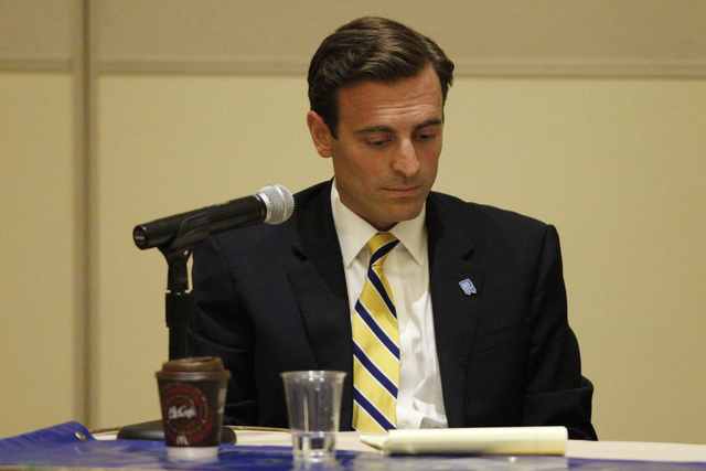 Nevada attorney general candidate Adam Laxalt looks at his notes during his first debate against his opponent Ross Miller at Aliante casino-hotel in North Las Vegas Saturday, Sept. 20, 2014. The d ...