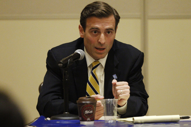 Nevada attorney general candidate Adam Laxalt speaks during his first debate against his opponent Ross Miller at Aliante casino-hotel in North Las Vegas Saturday, Sept. 20, 2014. The debate was sp ...
