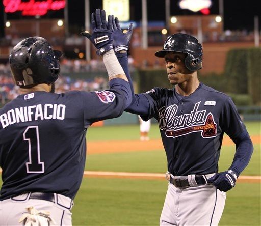 Atlanta Braves' B.J. Upton is congratulated by Emilio Bonifacio after hitting a home run in the third inning of a baseball game against the Philadelphia Phillies, Saturday, Sept. 27, 2014, in Phil ...