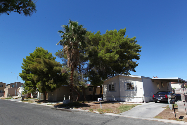 Homes are seen in the 3700 block of Kolanut Lane, Monday, Sept. 22, 2014, where a shooting occurred in a backyard in the area on Sunday morning, Sept. 21. The neighborhood is near Lake Mead Boulev ...