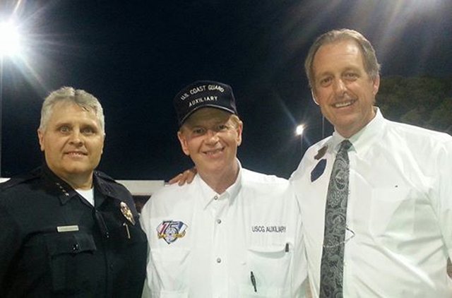 North Las Vegas Flotilla Cmdr. Barry Keller, center, North Las Vegas Mayor John Lee, right, and North Las Vegas Police Chief Joseph Chronister are photographed during National Night Out in North L ...