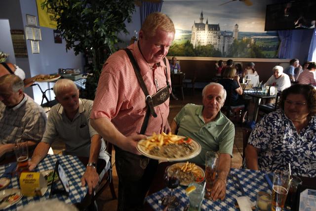 Rainer Doehler serves diners at the Bavarian Castle restaurant in Henderson on Sunday, Sept. 14, 2014. (Justin Yurkanin/Las Vegas Review-Journal)