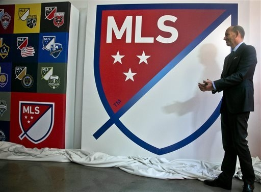 Major League Soccer Commissioner Don Garber launch the league's new logo during a press conference Thursday, Sept. 18, 2014, in New York.  (AP Photo/Bebeto Matthews)