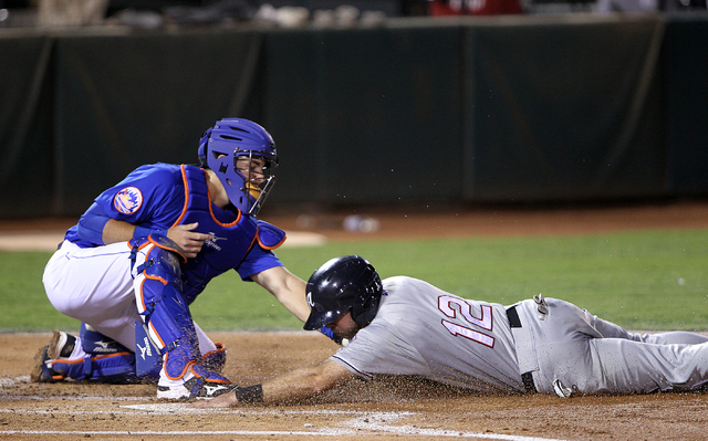 Las Vegas 51s catcher Kevin Plawecki tags out Reno Aces center fielder Michael Freeman in the xxx inning of Game 2 of their PCL Conference Championship Series at Cashman Field Thursday, Sept. 7, 2 ...