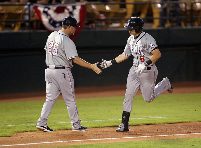 Reno Aces first baseman Mike Jacobs gets congratulated by Manager Phil Nevin after hitting a grand slam against the Las Vegas 51s in the first inning of Game 2 of their PCL Conference Championship ...