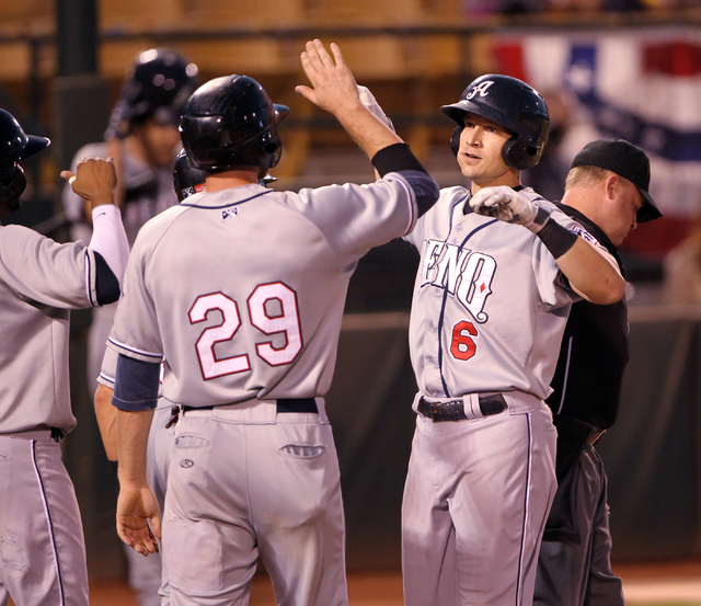 Reno Aces first baseman Mike Jacobs (6) gets congratulated by teammates including right fielder Roger Kieschnick after hitting a grand slam against the Las Vegas 51s in the first inning of Game 2  ...