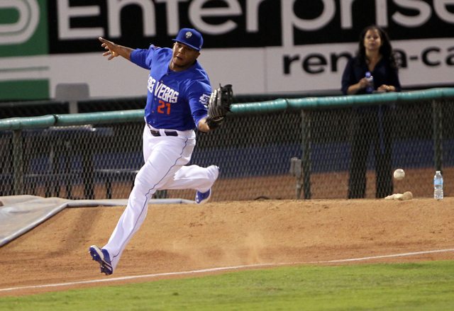 Las Vegas 51s left fielder Cesar Puello misses a Reno Aces fly ball in the first inning of Game 2 of their PCL Conference Championship Series at Cashman Field Thursday, Sept. 7, 2014. (K.M. Cannon ...