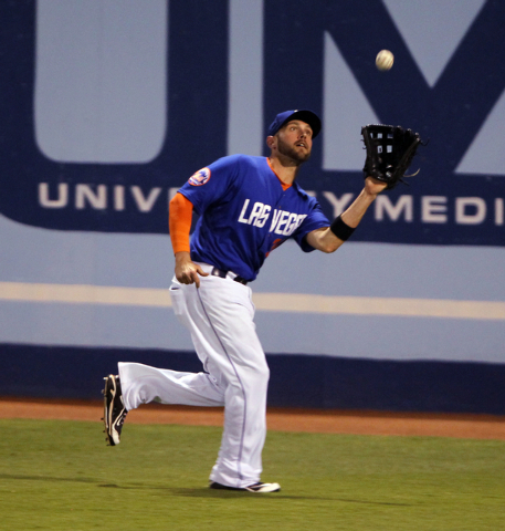 Las Vegas 51s right fielder Andrew Brown catches a Reno Aces fly ball in the eight inning of Game 2 of their PCL Conference Championship Series at Cashman Field Thursday, Sept. 7, 2014. (K.M. Cann ...